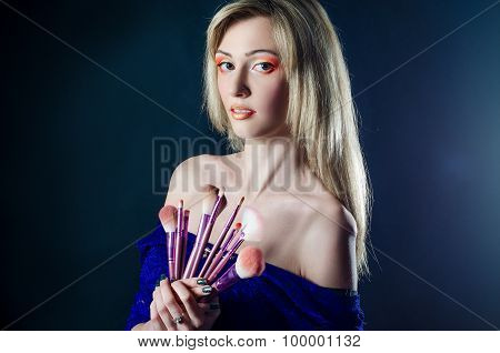 Girl with make-up brushes