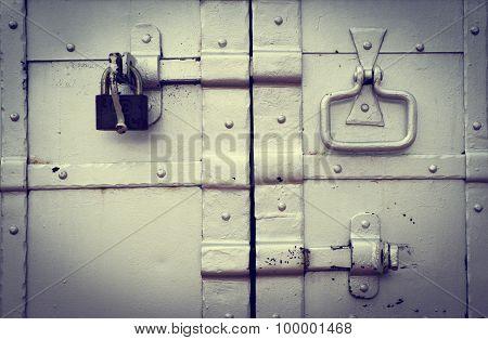 Steel lock on the rusty metal door