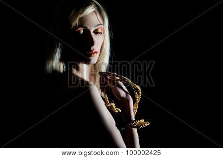 Beautiful girl with a rope and bright makeup