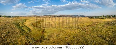 aerial panorama of foothills prairie along Front Range of Rocky Mountains near Fort Collins, Colorado, summer scenery lit by sunrise - Cathy Fromme Prairie Natural Area