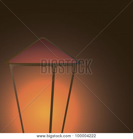 lantern shining in the dark to the left