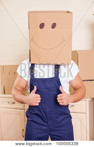 Cheerful young worker is making fun during packing