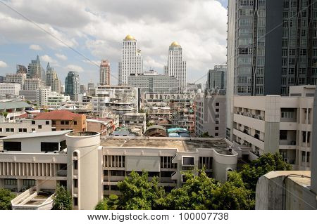BANGKOK, THAILAND - JUNE 19, 2015: view on Bangkok from City Line Train. Bangkok is the capital and the most populous city of Thailand.