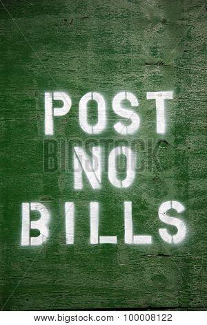 Post no bills written on construction site barrier