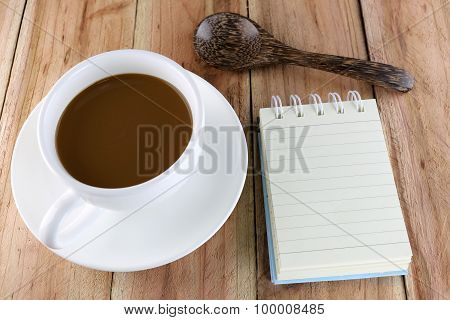 White Coffee Cup And Notebook.