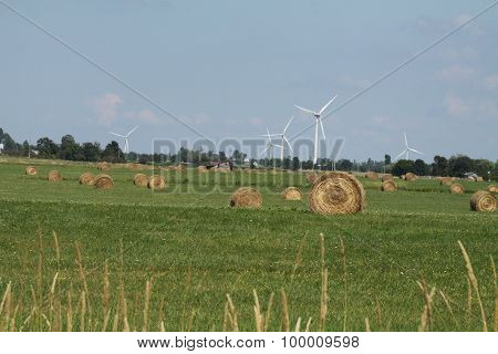 Hay Bales and Turbines in Field