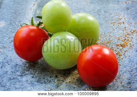Cherry tomatoes on metallic background