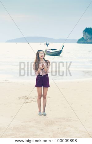 Asian Woman Take Selfie Photo On Beach