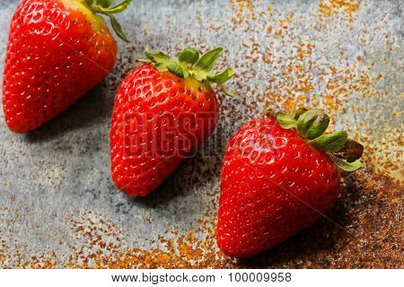 Strawberries on a rustic metallic background