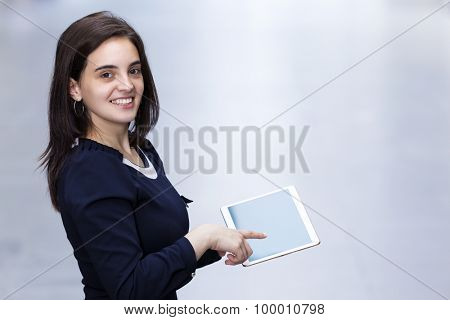 Image of a cute woman with a tablet computer