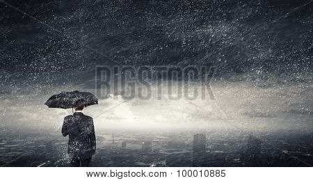 Man with black umbrella