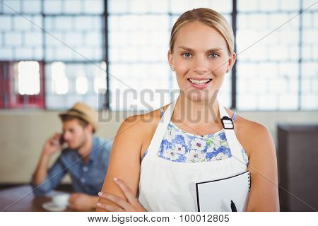 Portrait of a beautiful waitress taking an order in a cafe