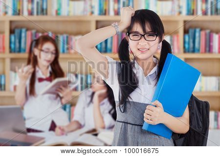 Confused Student With Group In Library