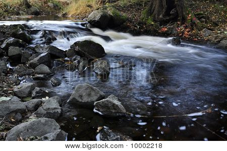 Scenic stream in autumn