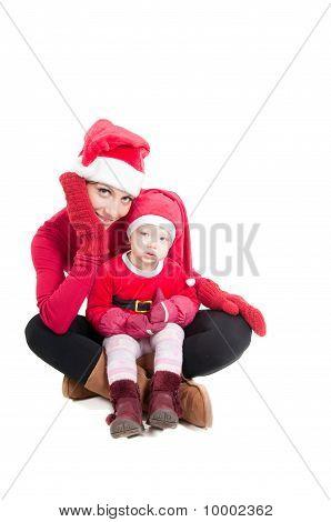 Santa mother and daughter in studio