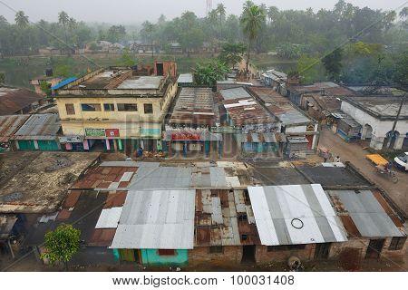 View to the slum houses in downtown Puthia, Bangladesh.