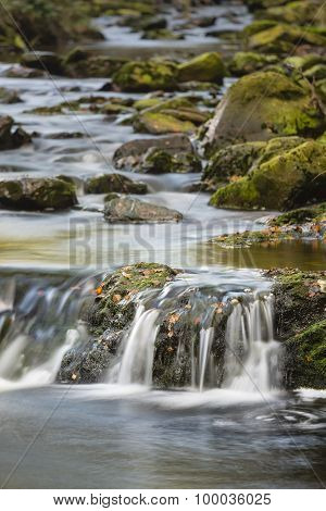 Little waterfalls in a mountain river in the High Fens Ardennes Belgium long exposure shot poster