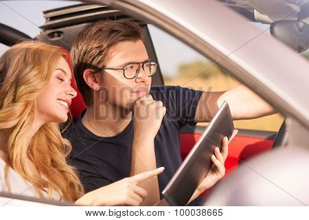 Pretty young loving couple is traveling by transport