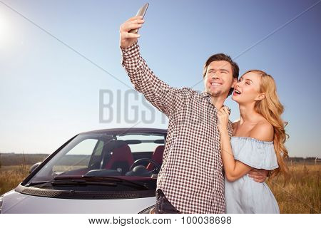 Cheerful young loving couple is enjoying their trip