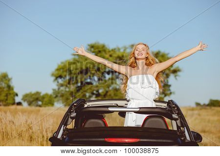 Attractive young loving couple is traveling by car