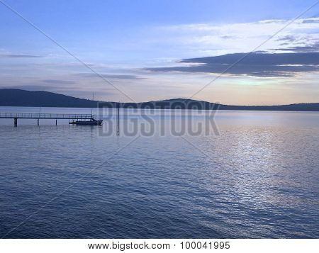 A pier at Cultra stretching into the sea at sunset