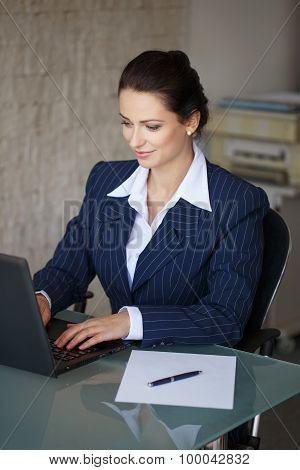 Brunette Secretary Typing Letter On Laptop