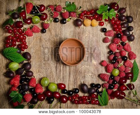Frame From Summer Berries On Wooden Background