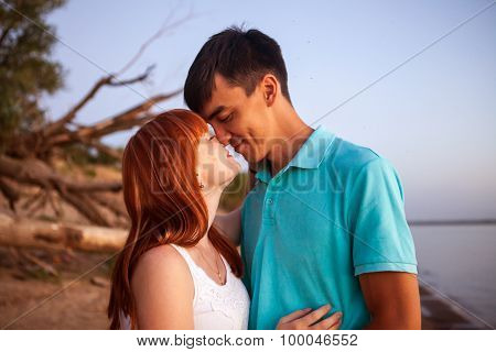 Young Couple Looking In One Direction, The Distance In The Park, Close-up