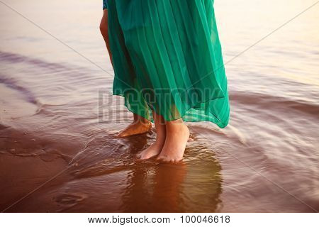 Feet Of Men And Women In The Water Close Up