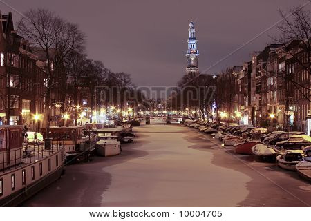 The Westerkerk in Amsterdam Netherlands covered with snow