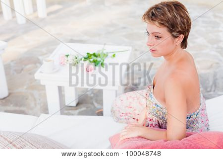 Pretty woman in outdoor cafe