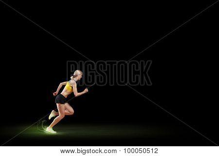 Female athlete running at full speed