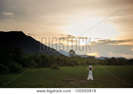 Blonde Girl In Vietnamese Dress Backside View On Field