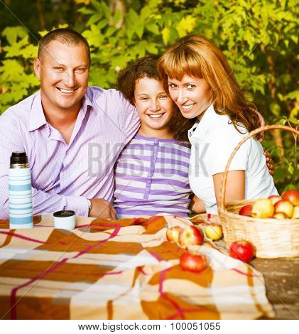 Happy Family With Daughter On Autumn Picnic