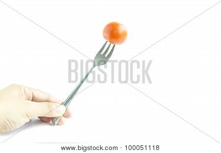 Fresh Red Tomato With Fork By Hand