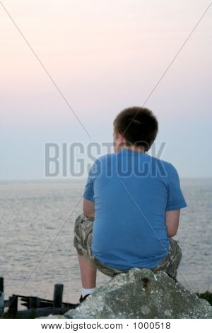 Pensive Beach Teen Boy