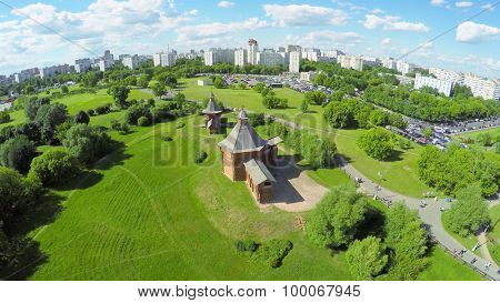 MOSCOW - JUN 06, 2015: Museum of Wooden Architecture in Kolomenskoe district during open air holiday Times and Epochs at summer sunny day. Aerial view