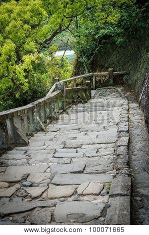 Stone brick ladder walkway on hill in Japan