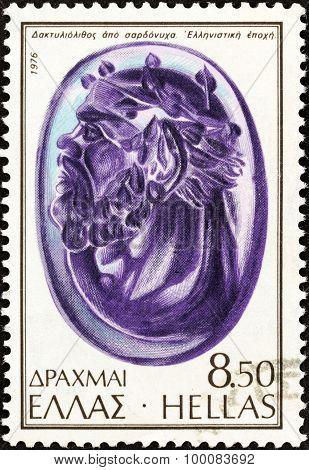GREECE - CIRCA 1976: A stamp printed in Greece shows Head of Silenus, sardonyx, Hellenistic period