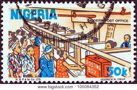 NIGERIA - CIRCA 1973: A stamp printed in Nigeria shows a modern post office