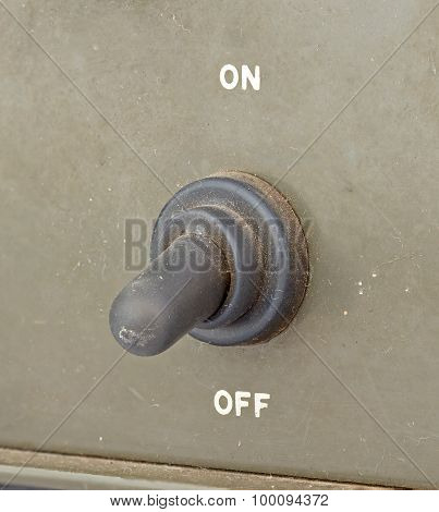 Old Black Toggle Switch On Green Surface - Off