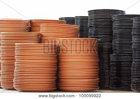 Stack of brown and black plates in warehouse.