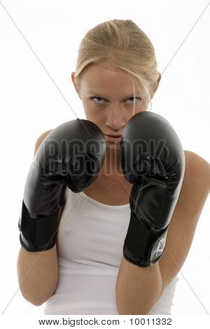 portrait of a young caucasian woman who does kick boxing with boxing gloves