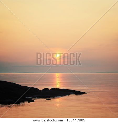 Ladoga Lake At Sunset. Calm Water. A Boat On The Horizon.