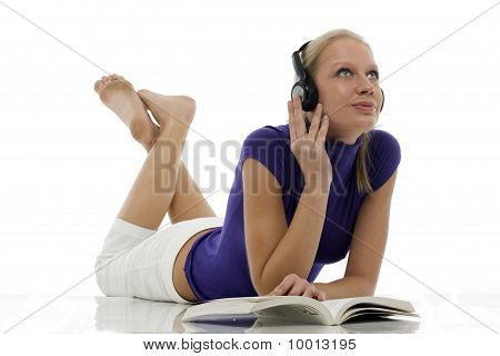 portrait of a young caucasian woman with casual clothing with book and headphones