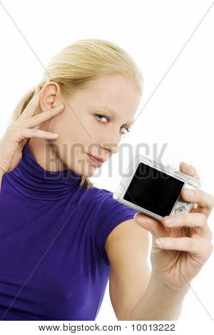 portrait of a young caucasian woman making a self portrait with a digital camera