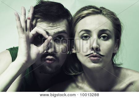 Young Man And  Woman With  Mustache