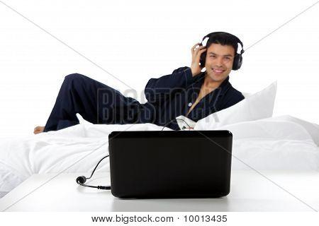 Young Nepalese Man In Pajamas, Laptop.