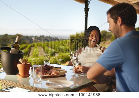 Happy Young Couple At Winery Restaurant