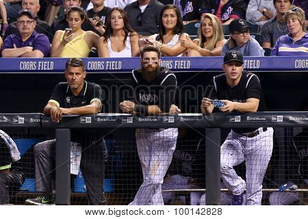 DENVER-AUG 21: Colorado Rockies outfielder Charlie Blackmon (C) in the dugout during a game against the New York Mets at Coors Field on August 21, 2015 in Denver, Colorado.